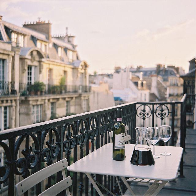Paris balcony at dusk.