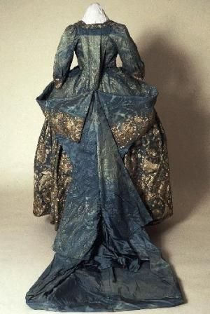 Court mantua and petticoat, 1720s. Light blue satin damask heavily embroidered with silver thread. The mantua has been altered and most of the train has been cut away; the petticoat is unaltered. From the Morgan family of Tredegar Park, Monmouthshire. Possibly worn by Lady Rachel Cavendish after her marriage to Sir William Morgan in 1720. by patrice
