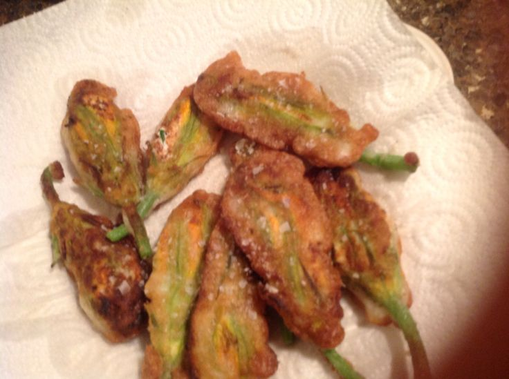 Zucchini Blossoms - Ricotta and fresh herbs from our garden.  Prosecco lightens the tempura batter.  Yummy!