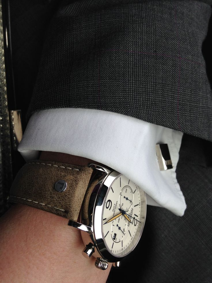 1888 Roamer watch brown leather. Grey Ted Baker suit with purple thread.