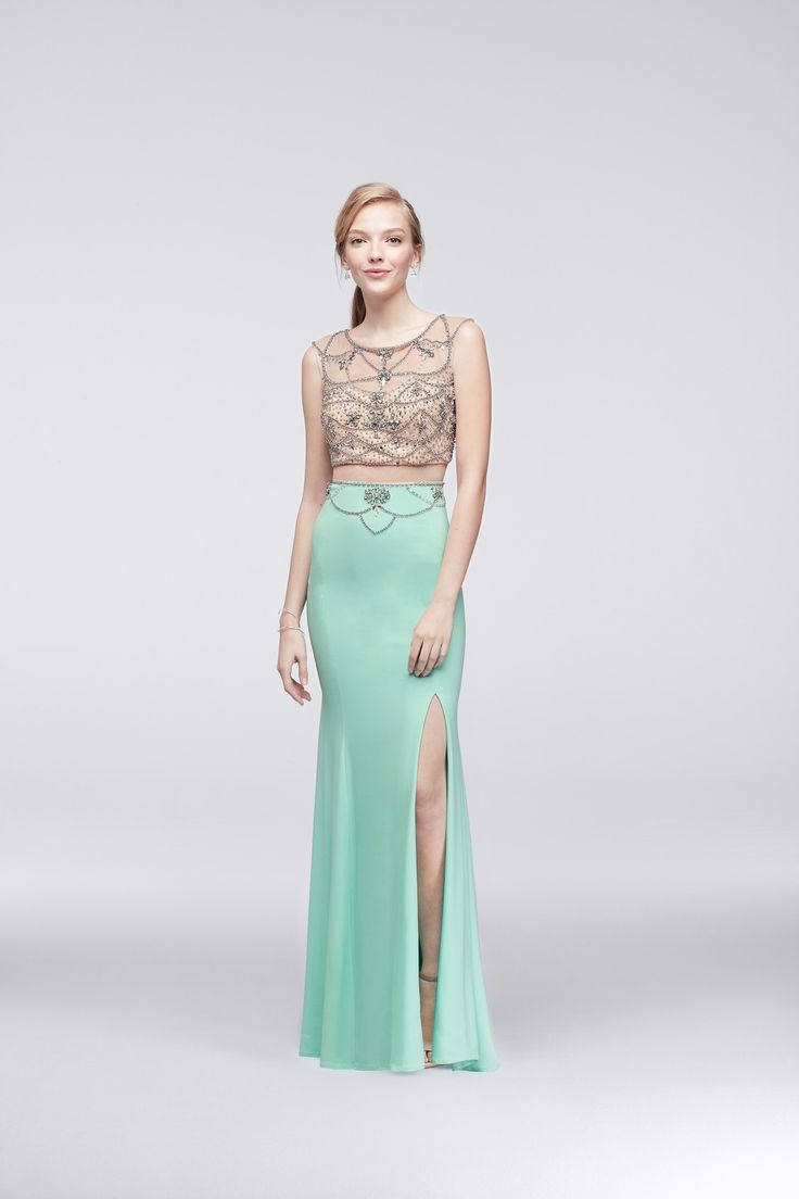 Dramatic lines of beading fall from the illusion bodice onto the slit jersey skirt of this chic gown.   Mint two piece prom dress by Decode 18 available at David's Bridal