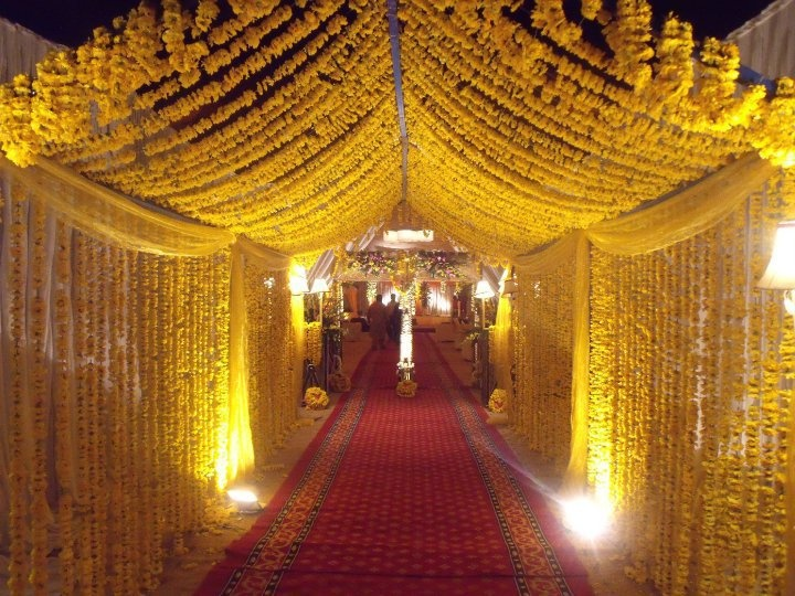 canopy decor at the pathway using marigold flowers for a traditional indian wedding - Orange Canopy Decorating