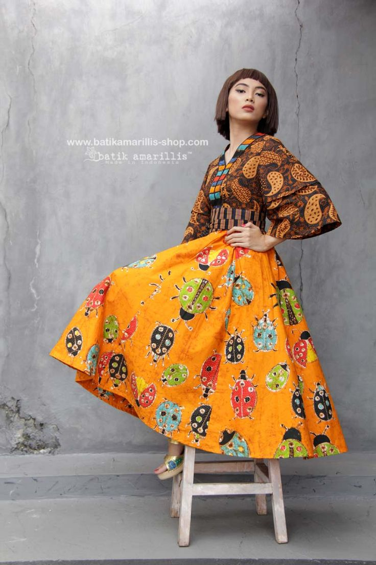 Batik Amarillis made in Batik Batik Amarillis's Amarantha Dress  in the combos of classic truntum sogan Sragen and gorgeous batik wonogiren in ladybug  series - Taking inspiration from 70-ies with mediveal romanticism,Batik Amarillis maintains its distinct modern-bohemia signature - modest  yet unabashedly romantic .wear it with or without belt this V neck dress has slimming silhouette with its tiered bell sleeves  plus full skirt for ethereal  head-turning approach to occasion