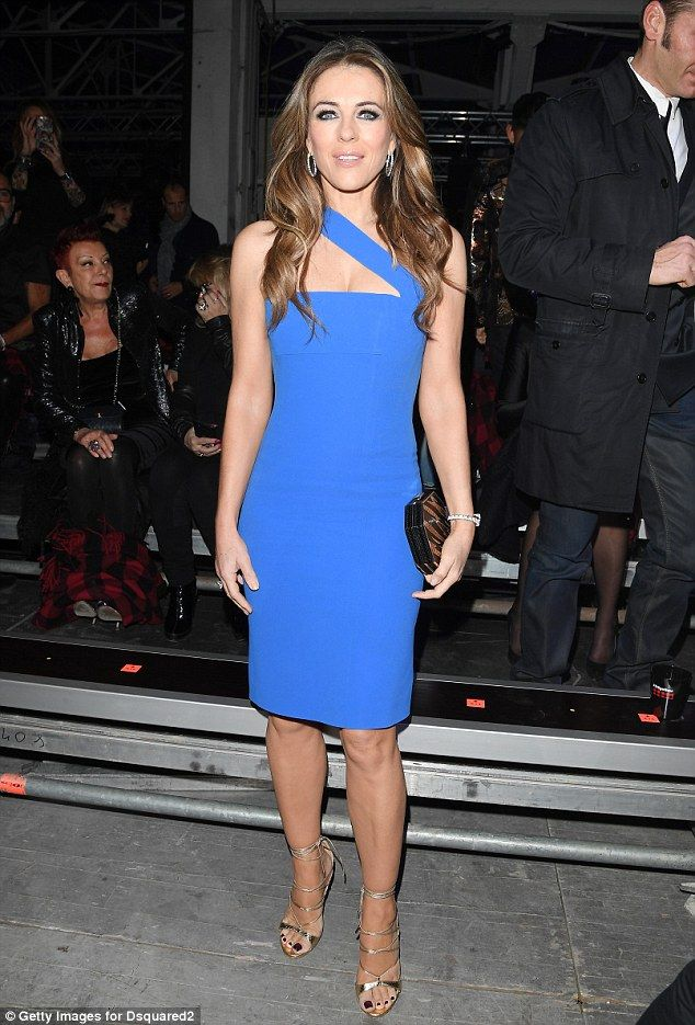 How does she do it? Elizabeth Hurley, 51, looked incredibly youthful in a blue midi dress with cross-shoulder detail as she attended Milan Men's Fashion Week on Sunday night