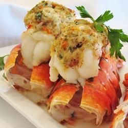 "Crab-Stuffed Lobster Tail | ""Lobster tail with a New England-style cracker and crabmeat stuffing. Serve with fresh lemon wedges and homemade dinner rolls for an exquisite but surprisingly simple meal."""