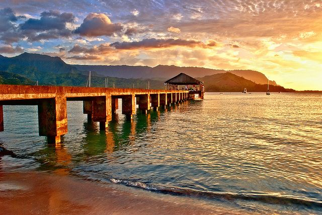 Hanalei Bay on the north shore of Kauai, Hawaii is hands down the most beautiful place I have ever been and quite possibly my favorite place ive ever been.