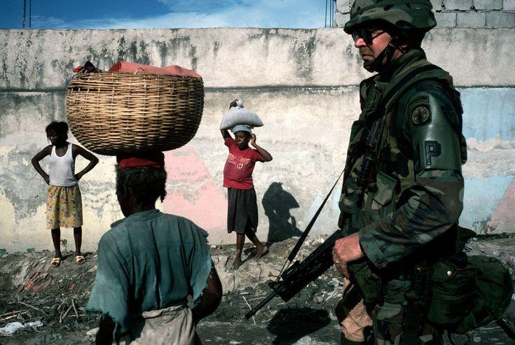 Alex Webb HAITI. Port-au-Prince. 1994. Arriving U.S. troops patrol the streets of the city.
