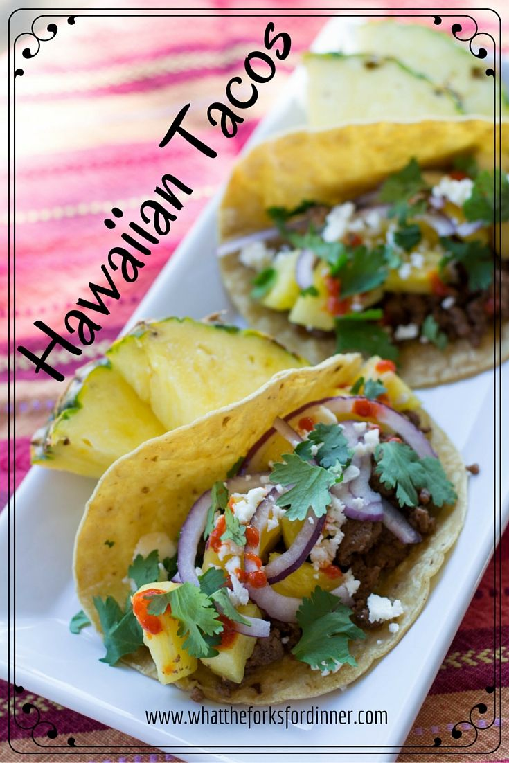 Hawaiian Tacos-Ground beef tacos with pineapple, red onion, Cotija cheese, cilantro and Sriracha sauce. Hawaiian twist to a Mexican favorite.