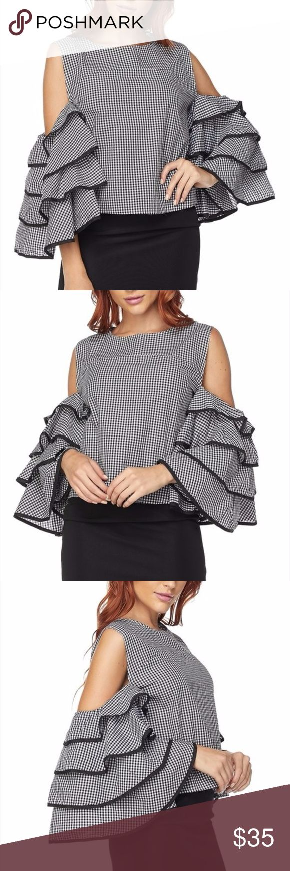 Cold Shoulder Wide Ruffle Sleev Blouse Fashion Top Sexy and trendy Cutout Cold shoulder Blouse Fashion Top with wide tiered Ruffle sleeves. Black and white checker pattern with black contrast trim on sleeves. Zipper back closure. Imported. Brand New in original factory bag.  Size S 2/4: Bust 33-34 Waist 25-26 Hips 35-36 Size M 6/8: Bust 35-36 Waist 27-28 Hips 37-38 Size L 10/12: Bust 37-38 Waist 29-30 Hips 39-40  Size chart provided as a guidance. Tops Blouses