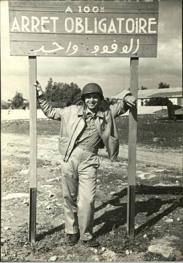 A soldier of the Western Task Force under a French Stop sign. Operation Torch November 1942