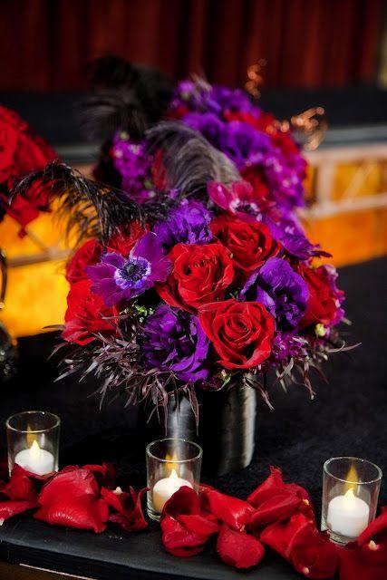 Red and purple centerpiece. #redpurple #crnterpiece. #eventdecor