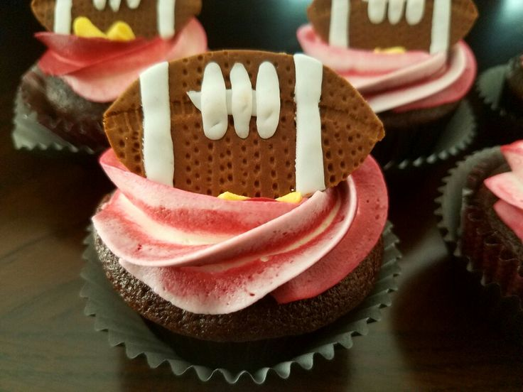 Chocolate cupcakes with buttercream and fondant football....little league party!!