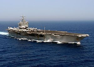 "USS Enterprise (CVN-65), formerly CVA(N)-65, is the world's first nuclear-powered aircraft carrier and the eighth United States naval vessel to bear the name. Like her predecessor of World War II fame, she is nicknamed the ""Big E"". At 1,123 ft (342 m),[3][4] she is the longest naval vessel in the world. Her 93,284 long tons (94,781 t)[2] displacement ranks her as the 11th-heaviest supercarrier, after the 10 carriers of the Nimitz class. Enterprise has a crew of some 4,600 people."