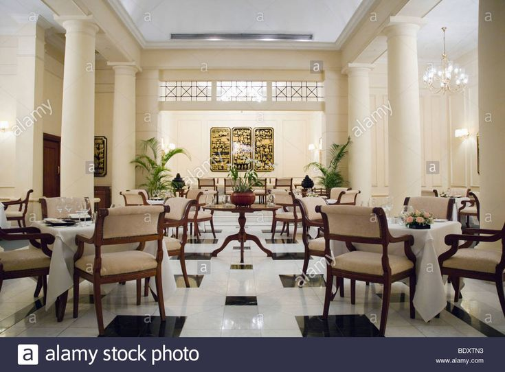 Download this stock image: Dining room, Strand Hotel, colonial hotel, Rangoon, Yangon, Burma, Myanmar, Asia - bdxtn3 from Alamy's library of millions of high resolution stock photos, illustrations and vectors.