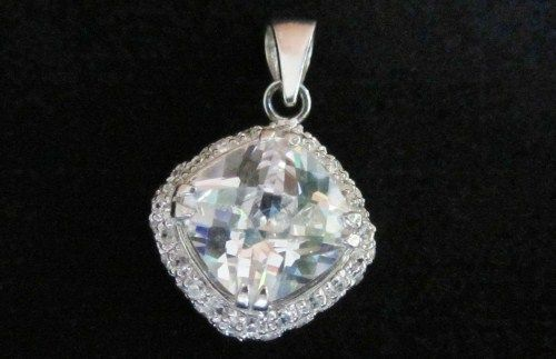 Sterling silver pendant with white zircons and a big white zircon.