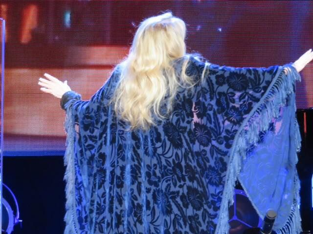 Stevie onstage  ~  ☆♥❤♥☆  ~   her golden hair tumbling down over her awesome 'Bella Donna' shawl, on December 1st, 2016 at Madison Square Garden, New York, NY during her '24 Karat Gold' US 2016 tour ~  https://www.stevienicksofficial.com/news/stevie-nicks-announces-27-city-north-american-24-karat-gold-tour-with-pretenders