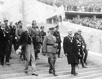 Hitler enters for the opening ceremony of the Berlin Olympics, 1936, accompanied by Theodor Lewald (left) and Count Baillet-Latour.