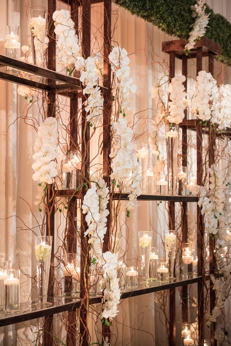 Bridal Stage backdrop with  phalaenopsis orchids and candlelight