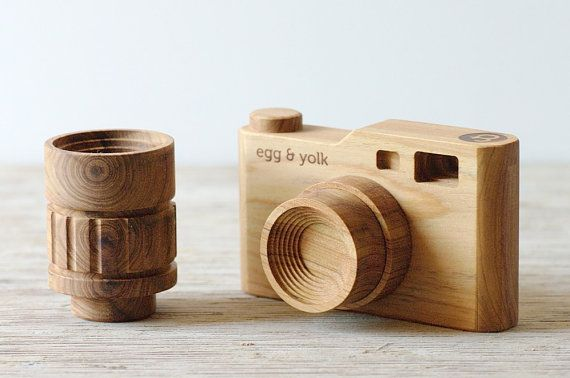 For the budding photographer: a toy wooden camera with interchangeable lenses.