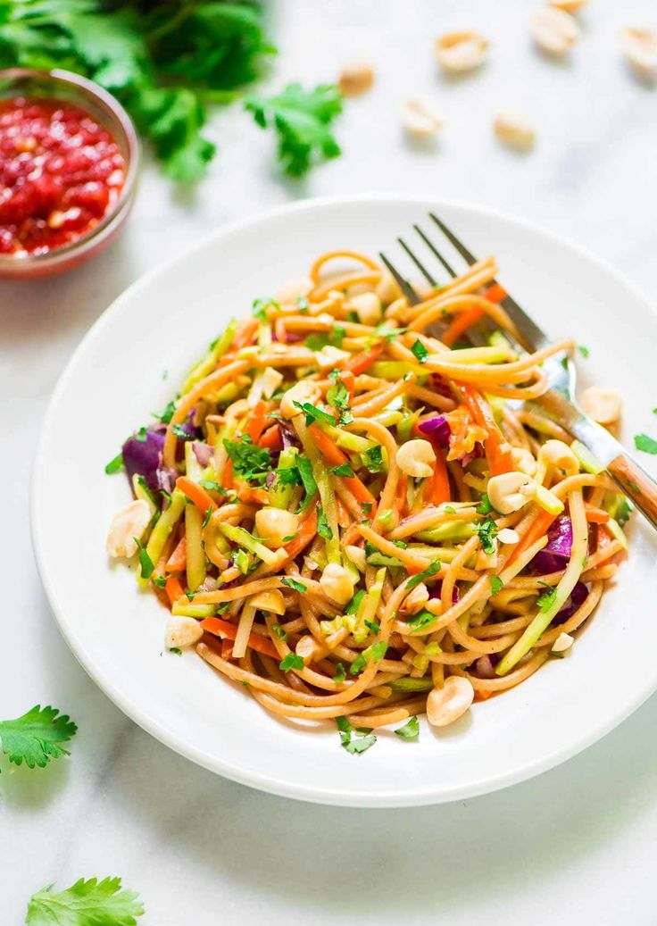 Asian Noodle Salad with Creamy Peanut Dressing. A flavorful, easy, and healthy cold pasta salad recipe! Easy to make ahead and feeds a crowd.