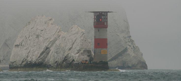 The Needles Lighthouse under mist. Isle of Wight, England