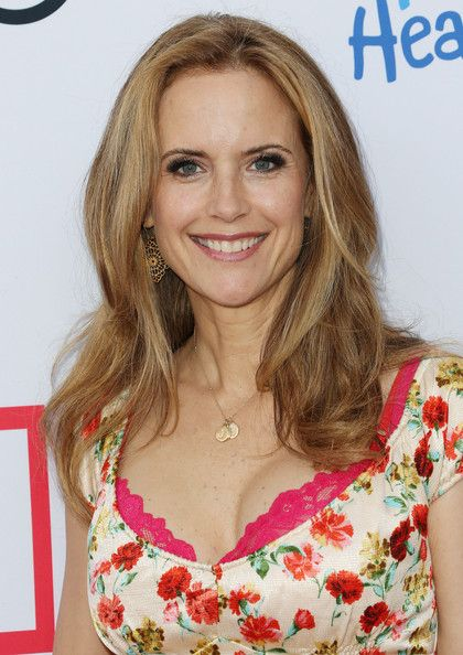 Kelly Preston Billowy waves added volume and texture to Kelly Preston's hair at the Children Mending Hearts Style Sunday.