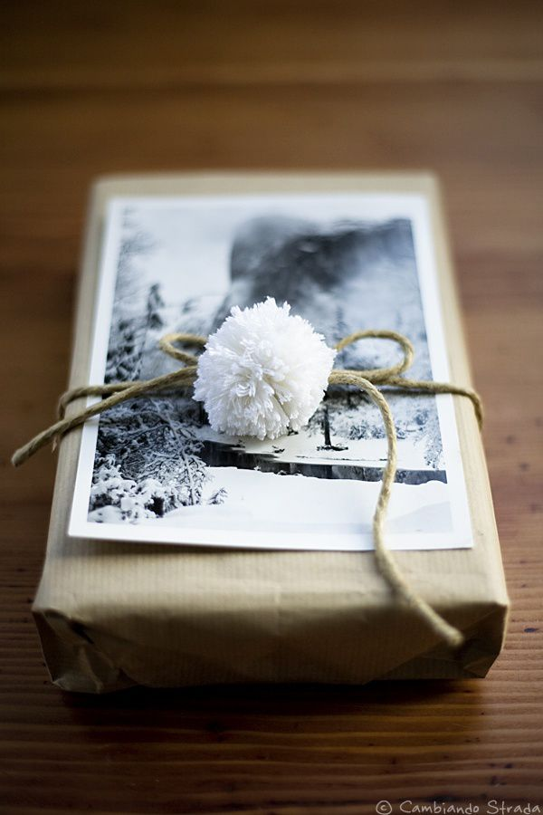 brown wrapping paper + black/white photography + brown yarn + little white pom pom: