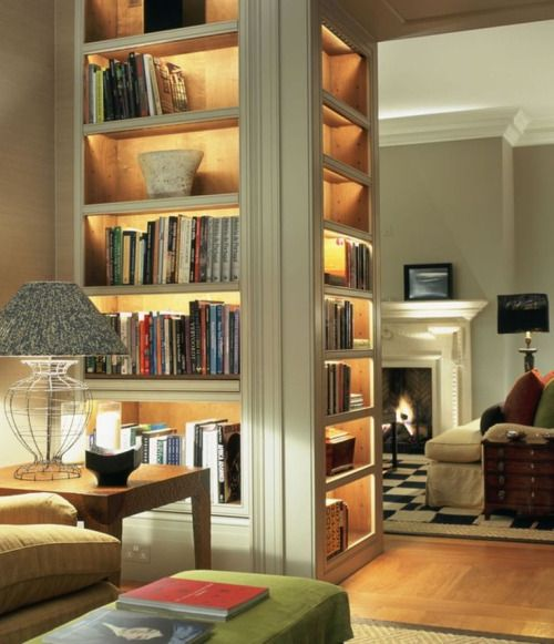 Bookshelves with lighting as a way to help light a large room at nightSource for the post: Click