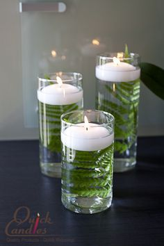 white floating candles can create a clean crisp look against an item placed inside a cylinder vase