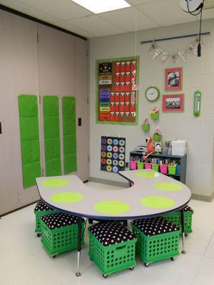 This is a great site! This picture in particular has two great things: crates (that are on wheels!) and dry erase dots on the table. Great way to let kids show and do their work. Maybe even put them on students' desks? What a great idea!: