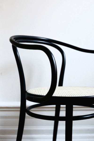 The timeless elegance of the Thonet 209 chair designed in 1900 by the Thonet brothers.