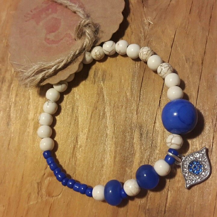 $10 pulsera elástica ojo de Isis (Synthetic White Howlite Turquoise Loose Beads Round White 6mm)