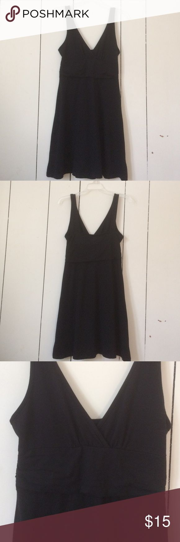 """knee length black dress sleeveless black dress. hits just above the knee on me (5'6""""). fabric crosses over at the bust. bra or no bra works. Patagonia Dresses"""