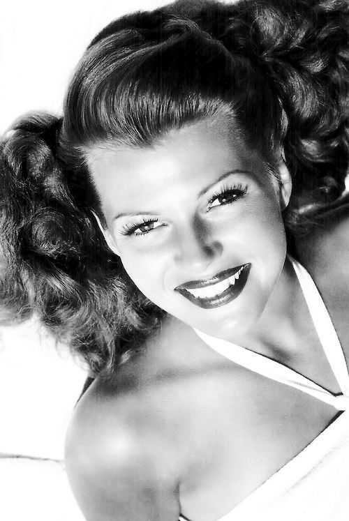 Rita Hayworth - I love the big quiff and curls in this. The use of liner really draw you into to eyes