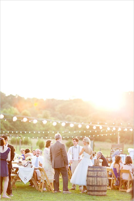 Outdoor wedding reception. Check out the lighting, and barrel! (maybe it's a wine barrel... :)