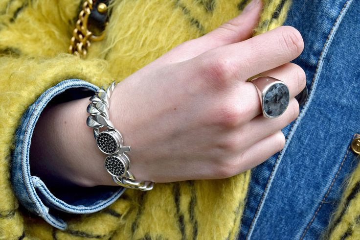 Our Camilla wearing the Slim Bracelet and ring with the Norwegian national stone Larvikite.