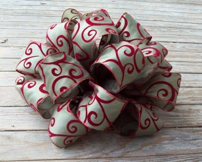 How to make those big, professional looking bows. I have been making them this way for years. This is a great tutorial. Great for Christmas tree toppers.