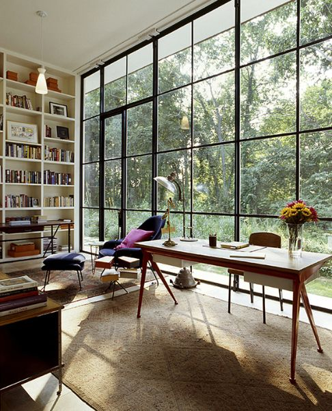 Michael Haverland's East Hampton study is a simple-yet-elegant glass box that the architect designed to showcase pieces from his blue-chip furniture collection, including a 1953 Jean Prouvé Compass desk and Standard chair; a 1946 Eero Saarinen for Knoll Womb chair; and a 1950s Jacques Adnet leather desk.