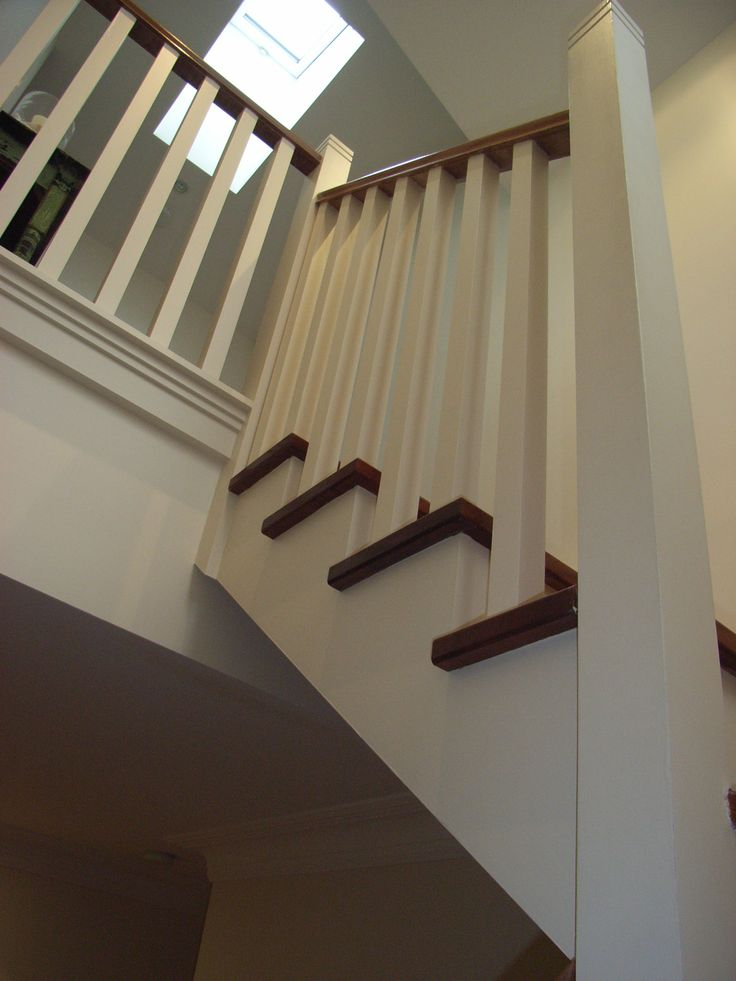 Cut string staircase with hardwood treads
