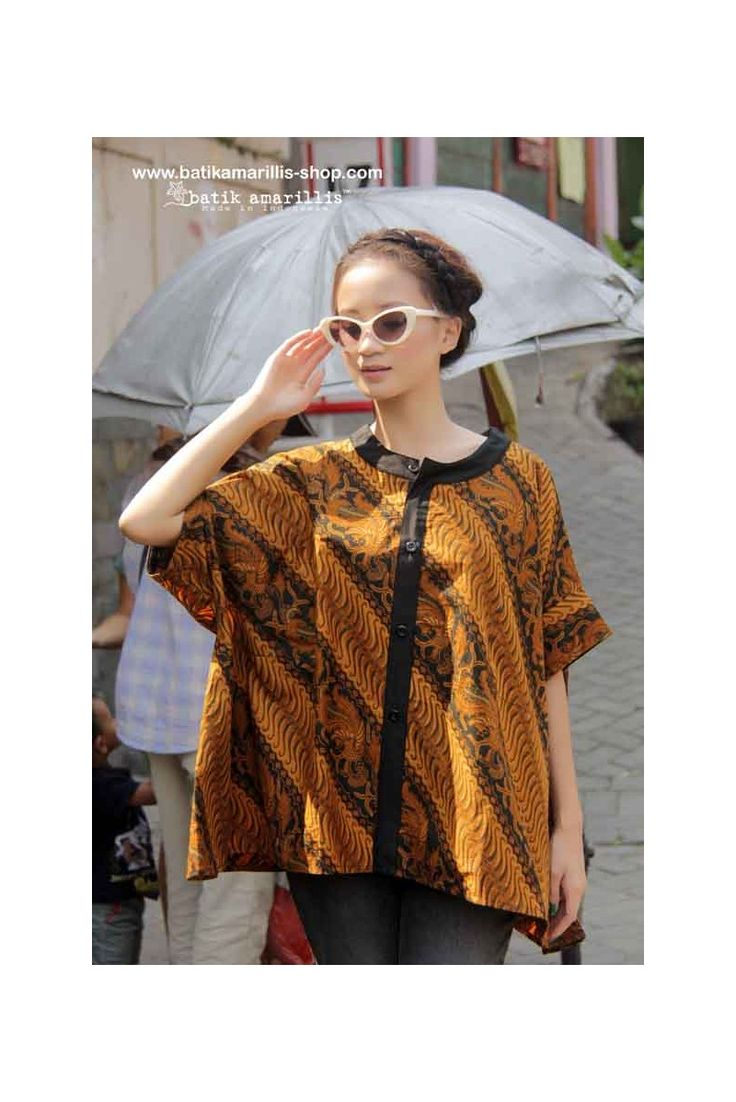 Batik Amarillis' Breezy Top .. it's Freesize , super cool,comfy ,sexy and swirling outfit with criss-cross back detail for you to enjoy and wear!!! Available at Batik Amarillis webstore www.batikamarilli...