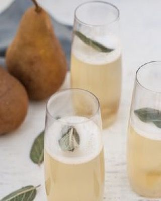 Fuel up with a winter-y cocktail: Pear and ginger-sage champagne from Dishing Up the Dirt/@andreabemis Yum. Follow us on Pinterest for this and more fabulous cocktail recipes. {pinterest.com/opalcollection} #Opalhappyhour #wintercocktails #champagnecocktail