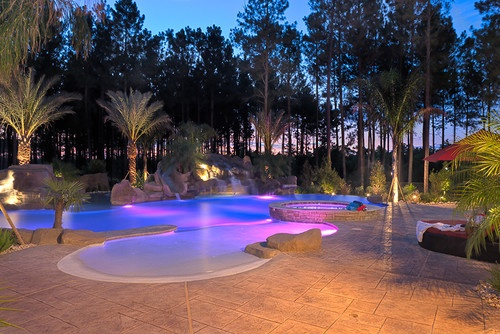 21 best images about top ideas for swimming pool lighting for Beach entry pool designs