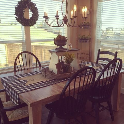 Breakfast nook with lots of light - love the mismatched chairs and chandelier eclecticallyvintage.com