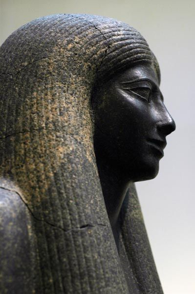 Granodiorite statue of Lady Sennuwy from Kerma (tumulus K III) originally from Egypt (possibly Asyut) and dating to the reign of Senusret I within the 12th Dynasty of the Middle Kingdom. Boston