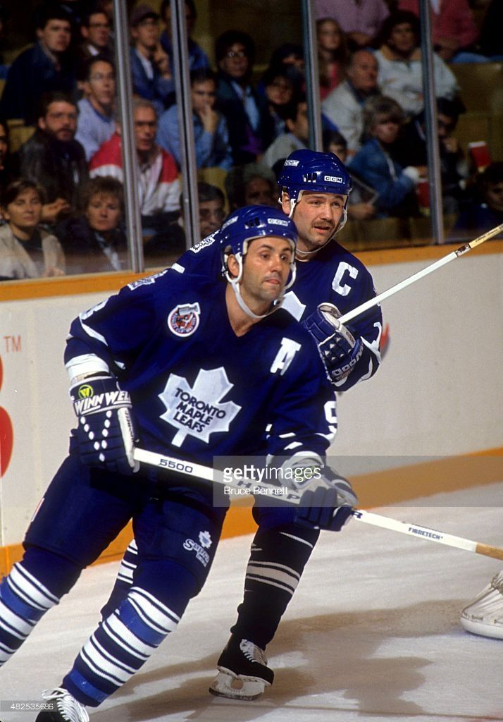 Doug Gilmour #93 and Wendel Clark #17 of the Toronto Maple Leafs skate on the ice during an NHL game in October, 1992 at the Maple Leaf Gardens in Toronto, Ontario, Canada.