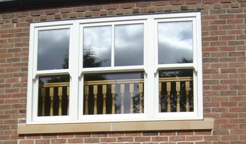 Timber sliding sash windows.