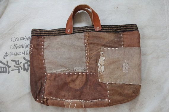 This is boro bag, made of few vintage japanese sakabukuro. They are sew pieces together by hand sashiko stitching. Lining and bound is sewn by