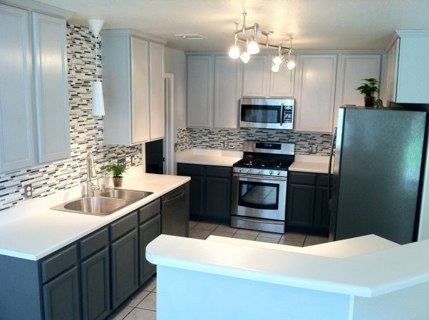 I love the clean black and white look of this kitchen.   Kitchen ...