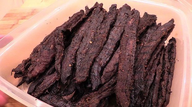 Perfect For Camping Food!How to smoke beef jerky on the WSM. Step by step instructions on how to prep your WSM, how to control your heat, and how to make the best homemade smoked beef jerky you've ever tasted!Smoked Peppered Beef Jerky Recipe4 lbs Flank Steak or Top Round2 tsp garlic powder2 tsp onion powder1.5 …