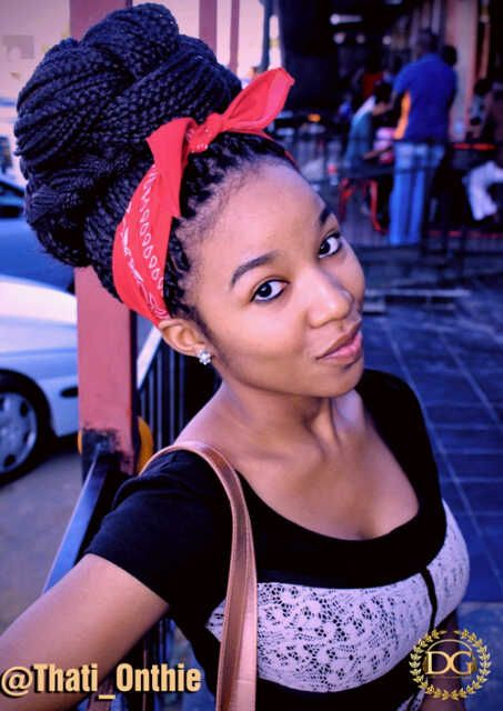 Box braids bun with red bandana; Great protective style for natural hair.